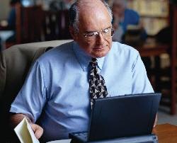 older man at laptop.
