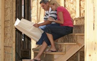 Couple with blueprint