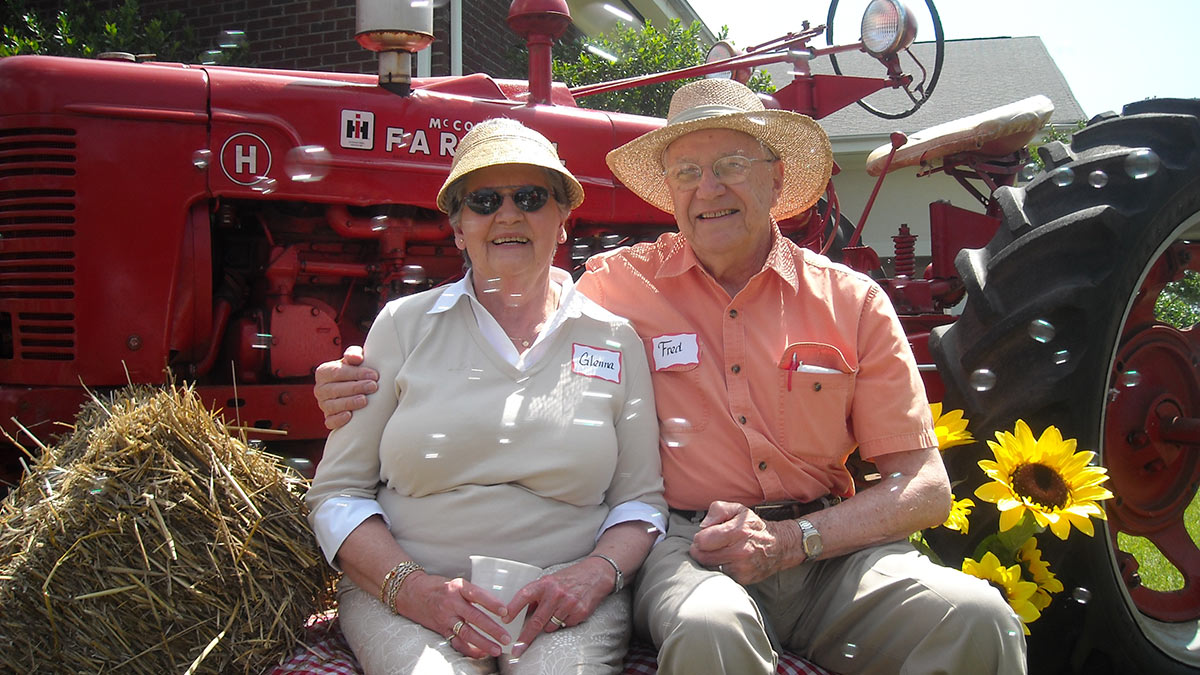 Windsor Point - Independent Living - Couple on the Tractor