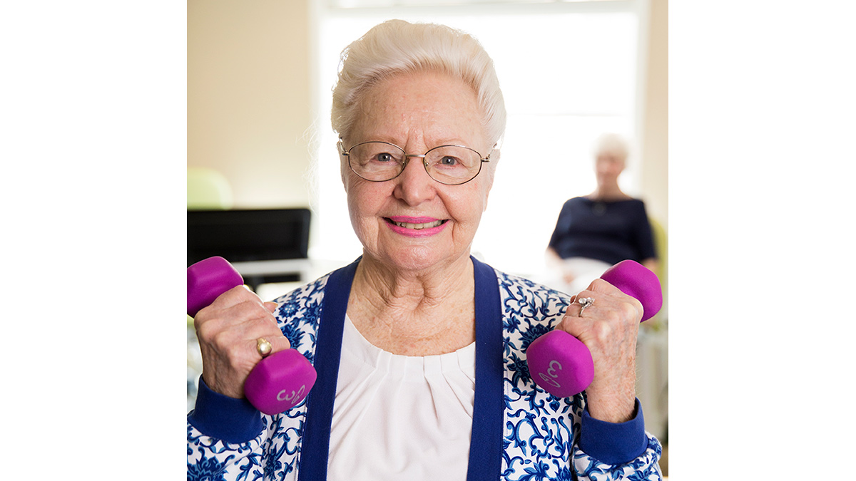 Kisco Senior Living - Abbotswood at Irving Park - Woman with Weights
