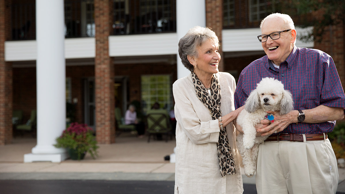 Kisco Senior Living - Abbotswood at Stonehenge - Couple with Dog