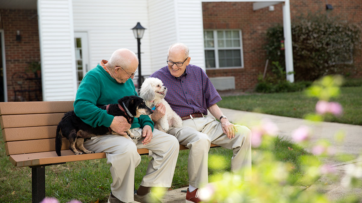 Kisco Senior Living - Abbotswood at Stonehenge - Men with Dogs
